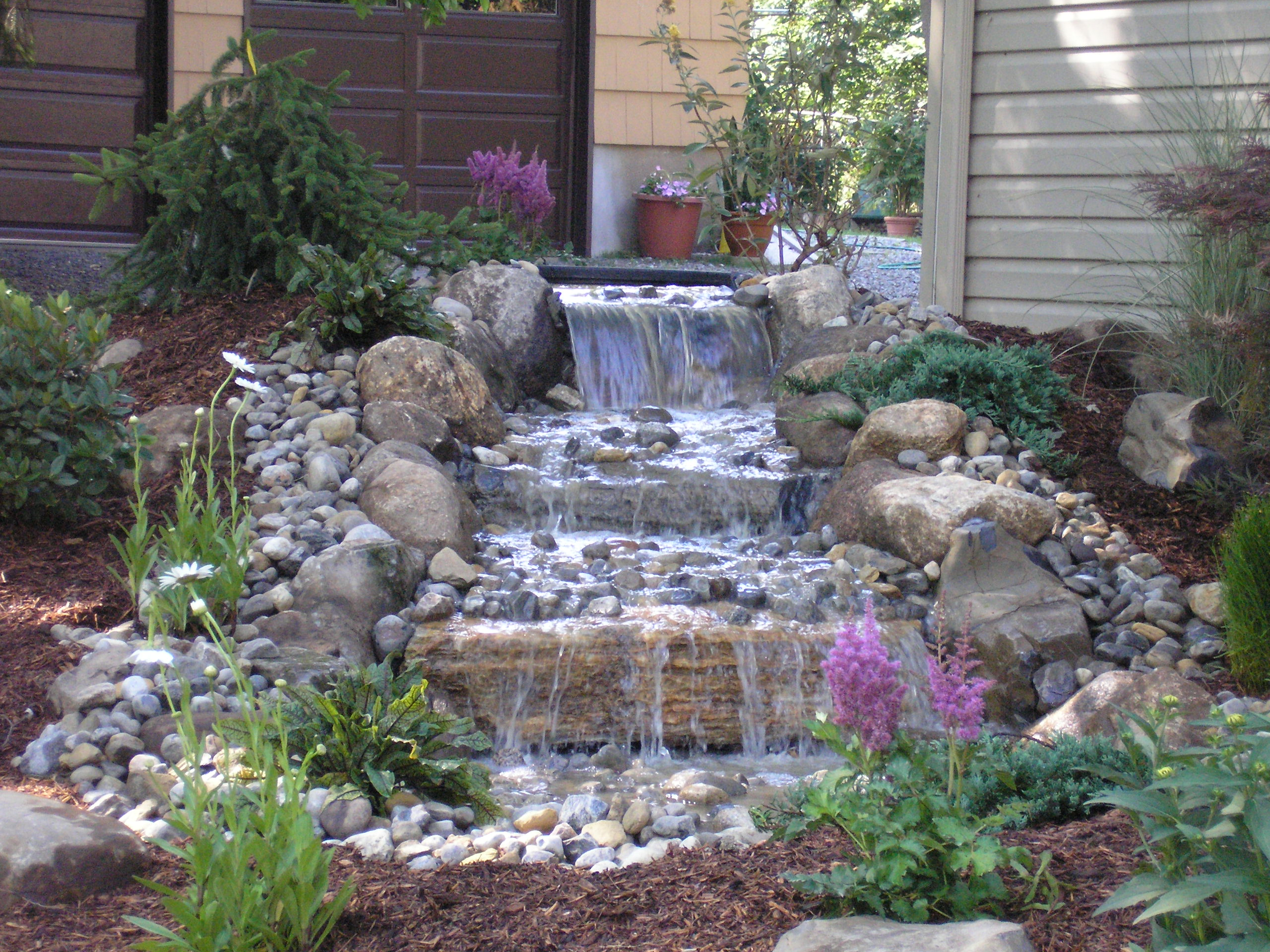 Pondless waterfall diy pond ideas water gardens for Build your own waterfall pond